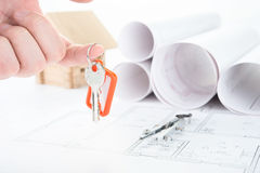 Blueprints hand with keys royalty free stock image