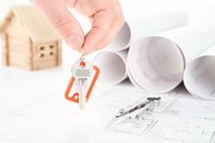 Blueprints hand with keys Stock Photo