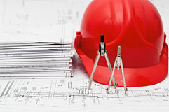 Blueprints, hard hat and compasses Royalty Free Stock Images