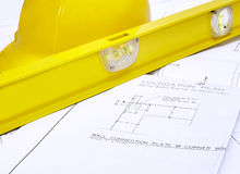 Blueprints with Hard Hat and Level Stock Photo