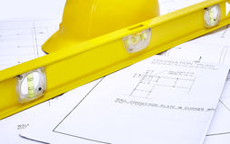 Blueprints with Hard Hat and Level Royalty Free Stock Image