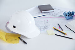 Blueprints, helmet and pens royalty free stock image