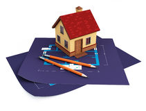 Blueprints and house. 3d image on white background Royalty Free Stock Photo