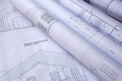 Blueprints of a house. And rolls royalty free stock photography