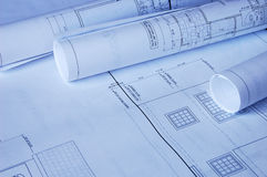 Blueprints of a house. And rolls Royalty Free Stock Photos