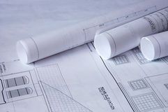 Blueprints of a house. And rolls Royalty Free Stock Photo