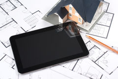 Blueprints, house and tablet Royalty Free Stock Photos