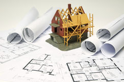 Blueprints and house Royalty Free Stock Photo