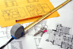Blueprints including measuring tape, keys Stock Photos