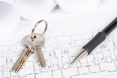 Blueprints and keys. Construction plans with two keys and drawing tools. Shallow depth of field royalty free stock images
