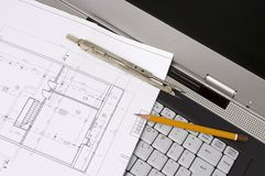 Blueprints and laptop. Pencil, dividers and blueprint on a Laptop royalty free stock images