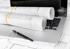 Blueprints and laptop Stock Image