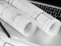 Blueprints and laptop Stock Images