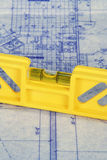 Blueprints and Level. Yellow level laying on blueprints Stock Photos