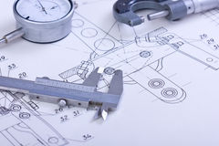 Blueprints and machine parts Stock Photos
