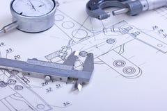 Blueprints and machine parts Stock Photos