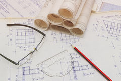 Blueprints. Old Blueprints with rencils, ruler, glasses Royalty Free Stock Photos