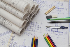 Blueprints. Old Blueprints with roolls and tools Stock Photo