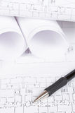 Blueprints and pencil. Construction plans and automatic pencil. Shallow depth of field royalty free stock photos