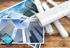 Blueprints and pictures of skyscrapers Royalty Free Stock Images