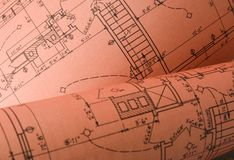 Blueprints-pink. Blueprints spread out and also rolled up Royalty Free Stock Photos