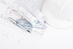 Blueprints and protective hat Stock Photography