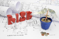 Blueprints and risk in the construction project Royalty Free Stock Images