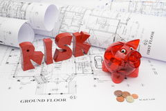 Blueprints and risk of exceeding budget in construction projects Royalty Free Stock Photography