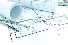Blueprints rolls, drawing compass and ruler on architectural pro Royalty Free Stock Photo