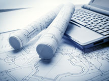 Blueprints rolls and laptop Stock Photo