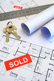 Blueprints with sold sign Stock Photos