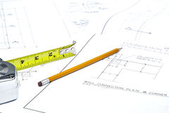 Blueprints with a Tape Measure and a Pencil Royalty Free Stock Image