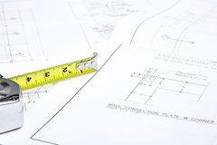 Blueprints and a tape measure Stock Images