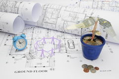 Blueprints, time, manpower, and money tree  in construction proj Stock Photo