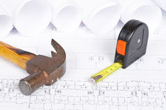 Blueprints and tools. Construction plans and tools. Shallow depth of field royalty free stock photo