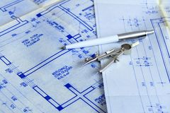Blueprints with tools. Architectural tools on big blueprints Royalty Free Stock Images