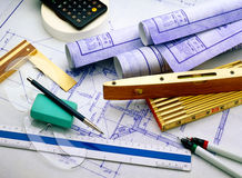 Blueprints with tools. Blueprints with architect and construction tools royalty free stock photos