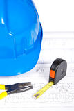 Blueprints and tools. Construction plans with hard hat and tools. Shallow depth of field royalty free stock images