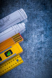Blueprints yellow ruler construction level and wooden meter on m Stock Photography