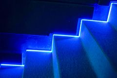 Bluer background,Stairs with lighting in the cinema.  stock image