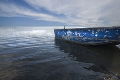 Blues. Old boat on the river coastline Royalty Free Stock Image