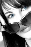 Blues. Black and white photo of a girl with blue eyes and big sunglasses Stock Image