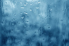 The blues. Window glass in a rainy day Royalty Free Stock Photos