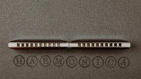 Blues diatonic harmonicas. Over dark grey background Stock Images