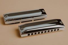 Blues diatonic harmonicas. Over pastel background Royalty Free Stock Photo