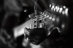 Blues guitar playing royalty free stock photography