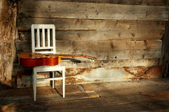 Blues guitar on a white chair with a wooden backgr Stock Photography