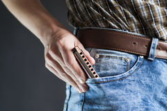 Blues harmonica in the pocket Royalty Free Stock Photo