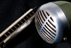 Blues harp and mic. Blues harmonica and microphone - the very essence of the blues!  Prepare to get down with feeling Stock Photos