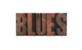 Blues in letterpress wood type. The word 'blues' in old, ink-stained wood letters isolated on white Stock Photo